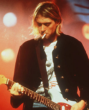 "An undated file photo shows ""Nirvana"" lead singer and guitarist Kurt Cobain performing on stage. Cobain committed suicide at his home in Seattle on April 8, 1994."