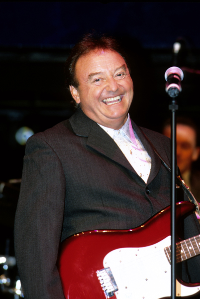 Musician Gerry Marsden performing on stage at London's Apollo Theatre