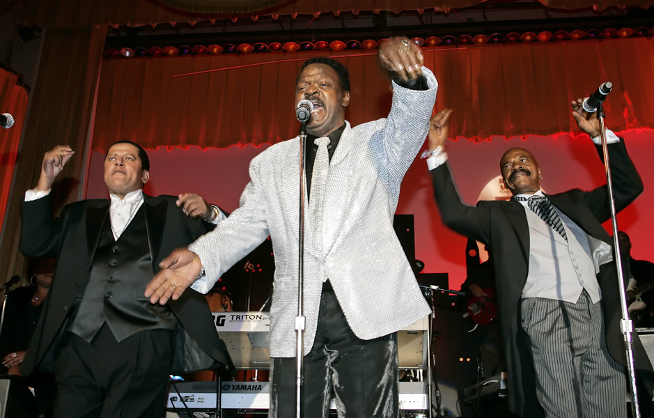 """The Delfonics, from left, Randy Cain, William """"Puggie"""" Hart, and brother Wilbert Hart, perform at the Rhythm & Blues Foundation's 14th annual Pioneer Awards in Philadelphia on Thursday, June 29, 2006, where they received an award. (AP Photo/George Widman)"""