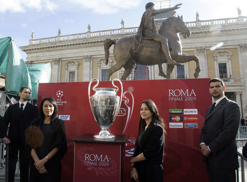 The Champions Legue trophy, at center, is photographed on display in Rome's City Hall Campidoglio square, under the statue of emperor Marcus Aurelius on horseback, part of the handover ceremony from the defending champion Manchester United to the final's host city, in Rome, Tuesday, April 21, 2009. Rome will be hosting the upcoming Champions League final in its Olympic stadium next May 27, 2009. (AP Photo/Pier Paolo Cito)