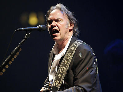 Neil Young performing the electric second half of his concert at the Hammersmith Apollo in west London.