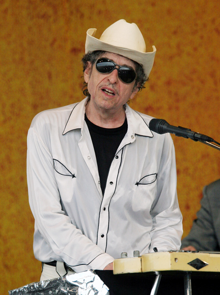 """**FILE**Bob Dylan performs during the 2006 New Orleans Jazz and Heritage Festival in New Orleans on April 28, 2006. Dylan's new album, """"Modern Times,"""" to be released Aug. 29, features 10 original songs recorded by Dylan and his touring band, Columbia Records said in a statement Monday, June 12, 2006.(AP Photo/Jeff Christensen)"""