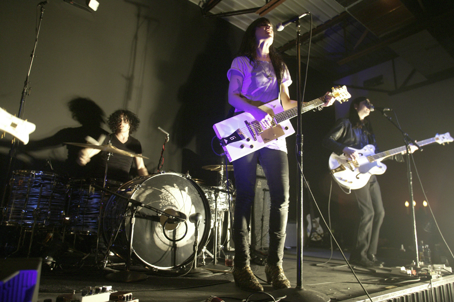 The Dead Weather, from left, Jack White on drums, singer Alison Mosshart, and Jack Lawrence on bass guitar perform in Nashville, Tenn., Wednesday, March 11, 2009. (AP Photo/Ed Rode)