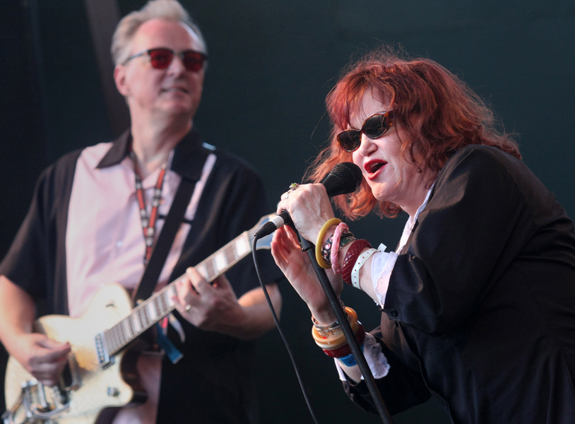 Exene Cervenka, right, and Billy Zoom of X perform at a day party during the SXSW Music Festival in Austin, Texas on Friday, March 14 , 2008. (AP Photo/Jack Plunkett)