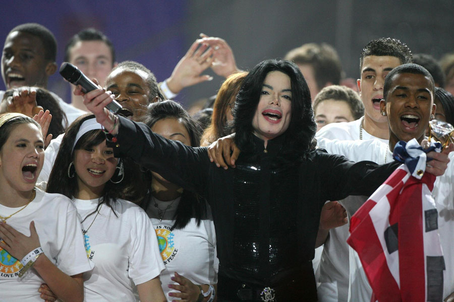 File photo dated 15/11/2006 of pop star Michael Jackson performing 'We Are The World', on stage during the World Music Awards at Earls Court in central London. He has been taken to hospital in California, reports said tonight.