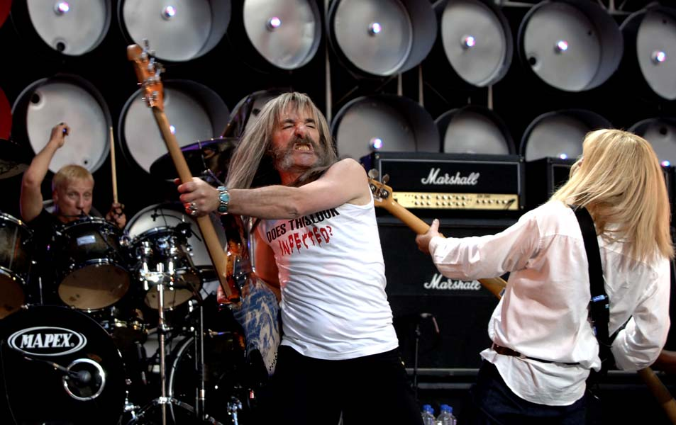 Harry Shearer of Spoof British band Spinal Tap performs on stage during the British leg of the Live Earth concerts at London's Wembley Stadium, Saturday July 7, 2007. This concert is part of a series of events, also taking place in the U.S., Australia, China, Japan, Brazil, South Africa and Antarctica. Live Earth was inspired and is backed by by former U.S. Vice President Al Gore's campaign to force global warming onto the international political agenda by generating public concern. (AP Photo/Anthony Harvey)