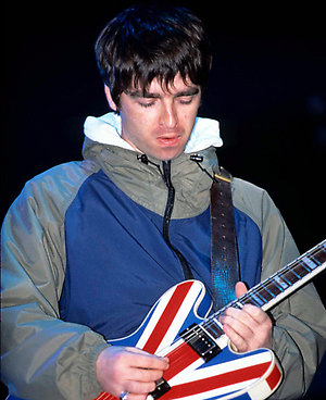 Noel Gallagher from Oasis performing live at Maine Road stadium in Manchester.