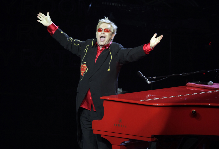 """Elton John takes a final bow after performing at his show """"The Red Piano"""" in Las Vegas, Wednesday, April 22, 2009. The Rocket Man is saying farewell to the Las Vegas Strip after five years and 241 shows. Elton John's last show was slated for Wednesday at Caesars Palace. He's scheduled to embark May 2 on a tour of the United States, Canada and Europe. (AP Photo/Jae C. Hong)"""