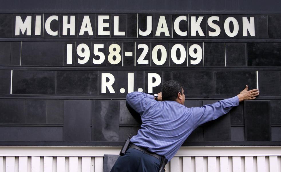 Rudy Ocegueda places letters on a marquee in tribute to Michael Jackson at a Holiday Inn hotel Tuesday, July 7, 2009 near the Staples Center where Michael Jackson's memorial is being held in Los Angeles. (AP Photo/Kiichiro Sato)