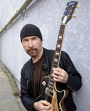 U2 guitarist David Evans, aka The Edge, poses for a photo Friday, Jan. 27, 2006, outside the Guitar Center in Los Angeles. The normally soft-spoken Evans, 44, grows passionate when he talks about Katrina's impact and his efforts to help with Music Rising, which he organized along with Gibson Guitar, the Guitar Center Music Education Foundation and the MusicCares Foundation to aid the musicians of flood-ravaged New Orleans. (AP Photo/Chris Pizzello)