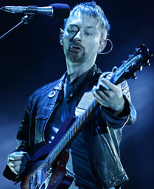 """** FILE **Thom Yorke, lead singer of the British band Radiohead, performs on stage at the 15th Rock Oz'Arenes music festival, in Avenches, Switzerland, in this Aug. 15, 2006, file photo. Radiohead's seventh studio album, """"In Rainbows,"""" was received Wednesday, Oct. 10, 2007 with online hysteria from fans, the blogosphere and music Web sites. (AP Photo/Keystone, Laurent Gillieron)"""