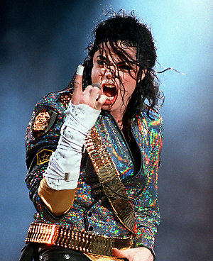 UNITED KINGDOM - AUGUST 18:  Photo of Michael JACKSON; Michael Jackson performing on stage, finger pointing up - Dangerous Tour,  (Photo by John Gunion/Redferns)