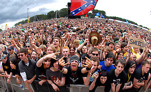 Festival-goers enjoy a performance by Alexisonfire on the first day of the Leeds Festival, Leeds.