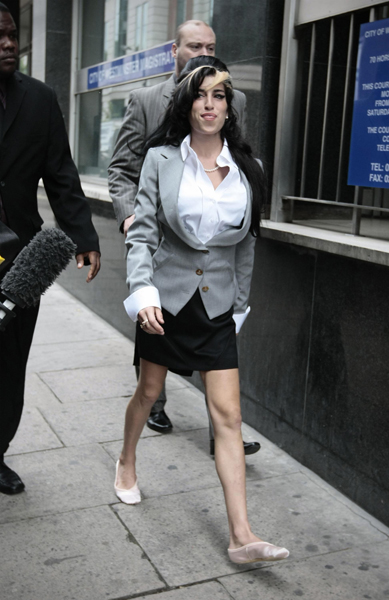 Amy Winehouse arrives at Westminster Magistrates Court on the second of a trial for alleged assault.