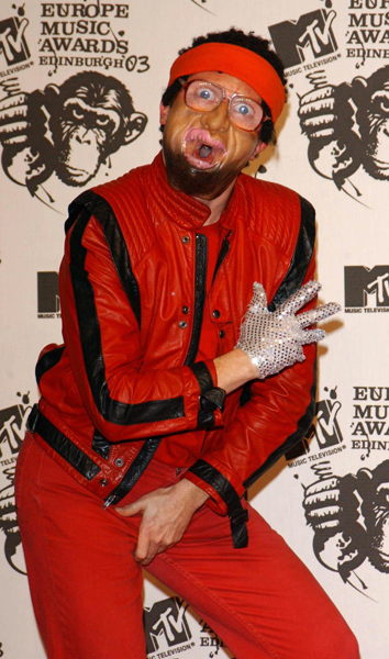 Comedian Avid Merrion, dressed as Michael Jackson backstage during the MTV Europe Music Awards 2003 at Western Harbour in Leith, Edinburgh.