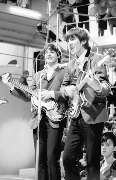 The Beatles - left to right Paul McCartney, George Harrison and Paul McCartney at Rediffusion's Wembley Studio rehearsing for 'Around the Beatles', the first British television show built around the group.