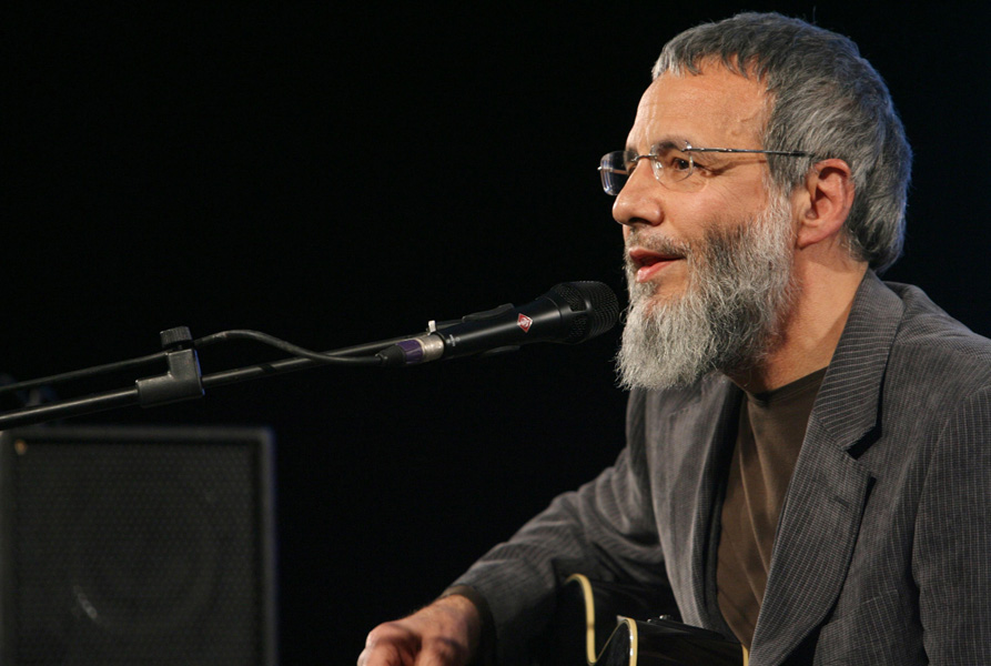 Yusuf Islam, also known as Cat Stevens, performs on stage at a Medical Aid for Palestinians (MAP) benefit evening for Gaza, held at the Grosvenor House Hotel in central London.