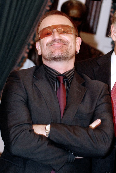 U2 frontman Bono attends a meeting with Sen. Joseph Biden and other Senators on Capitol Hill in Washington.