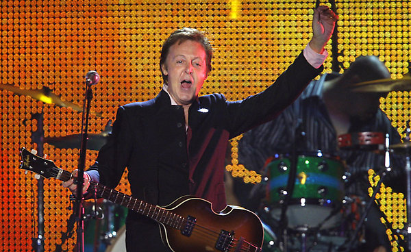"""Former Beatle Sir Paul McCartney performs during a concert in Tel Aviv, Israel, Thursday, Sept. 25, 2008. After a 43-year wait, Paul McCartney performed his first concert in Israel on Thursday, kicking it off with the familiar Beatles' song """"Hello, Goodbye"""" to the joy of tens of thousands of cheering fans. McCartney billed the concert """"Friendship First,"""" saying he is on a mission of peace for Israel and the Palestinians.(AP Photo/Bernat Armangue)"""