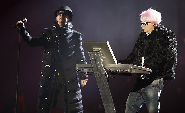British band The Pet Shop Boys, Neil Tennant, left, and Chris Lowe, right, perform after receiving The Oustanding Contribution To Music award at the Brit Awards 2009 at Earls Court exhibition centre in London, England, Wednesday, Feb. 18, 2009. (AP Photo/MJ Kim)