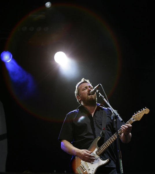 Guy Garvey of Elbow performing on the V Stage at the V Festival, at Hylands Park, Chelmsford, Essex.