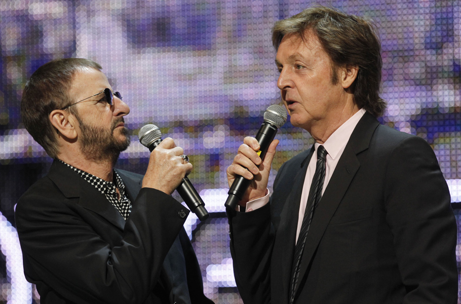 The Beatles band members Ringo Starr, left, and Paul McCartney are seen at the launch of The Beatles Rockband Xbox game at the Microsoft Xbox 360 E3 Expo on Monday, June 1, 2009, in Los Angeles. (AP Photo/Damian Dovarganes)