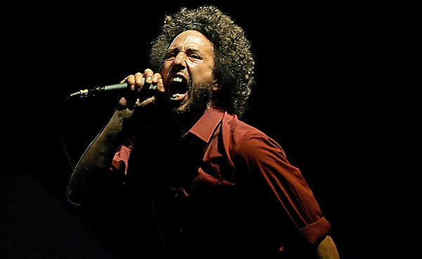 Zack de la Rocha of Rage Against The Machine performs at the Coachella Valley Music and Arts Festival in Indio, Calif., on Sunday, April 29, 2007. (AP Photo/Branimir Kvartuc)