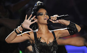 Rihanna performs at the 2008 MTV Video Music Awards held at Paramount Pictures Studio Lot on Sunday, Sept. 7, 2008, in Los Angeles. (AP Photo/Kevork Djansezian)