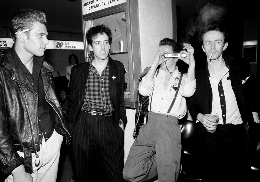 """FILE - In this 1983 file photo, members of the British punk band The Clash are shown. From left, Paul Simonon, Mick Jones, Joe Strummer and Terry Chimes. The era of one-price-fits-all-songs on iTunes came to an end Tuesday, April 7, 2009, as Apple Inc., the Internet's dominant digital music store, ended its practice of selling all songs for 99 cents each and began offering three tiers: 69 cents, 99 cents and $1.29. The hit song """"London Calling"""" by The Clash is one of many songs now available for 69 cents. (AP File Photo)"""