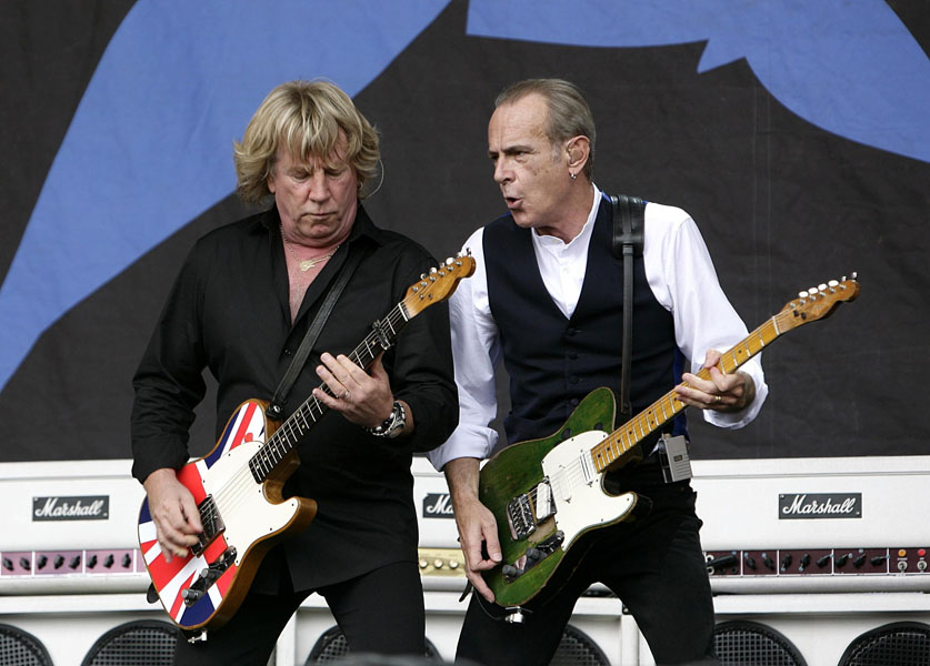 Rick Parfitt (left) and Francis Rossi of Status Quo performing during the 2009 Glastonbury Festival at Worthy Farm in Pilton, Somerset.