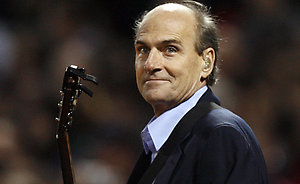 James Taylor prepares to sing the Star Spangled Banner before Game 2 of the World Series between the Colorado Rockies and Boston Red Sox Thursday, Oct. 25, 2007, at Fenway Park in Boston. (AP Photo/Kathy Willens)