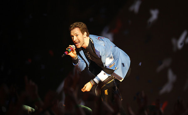 Chris Martin of British band Coldplay performs at the Brit Awards 2009 at Earls Court exhibition centre in London, England, Wednesday, Feb. 18, 2009. (AP Photo/MJ Kim)