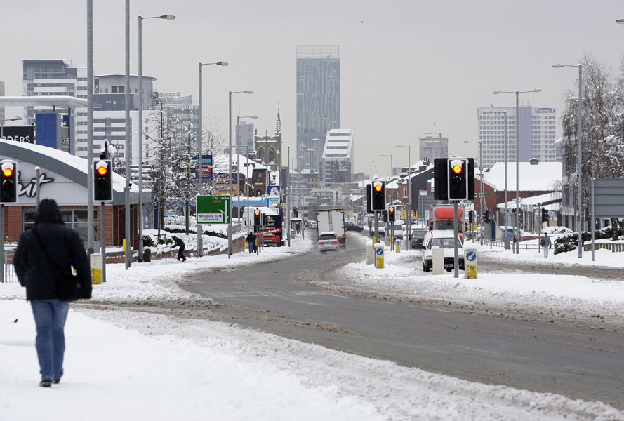 Central Manchester is seen from the north of the city after heavy snowfall across the region, in Manchester, England, Tuesday Jan. 5, 2010. Many schools have been closed and some airports have suspended flights after heavy snowfall across large areas of the country, as Britain's authorities has issued severe weather warnings. (AP Photo/Jon Super)