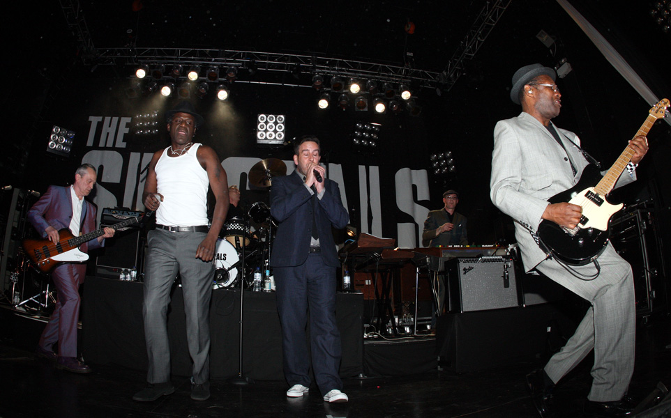 Members of the band, The Specials, are seen performing on their opening night to start off their reunion tour at the Academy in Newcastle, England, Wednesday, April 22, 2009. (AP Photo / Scott Heppell)