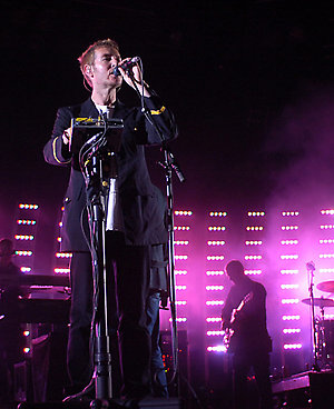 Robert del Naja, front, Singer and Member of the British band Massive Attack, performs during a concert at the Open Air Festival in St. Gallen, Switzerland, on Friday June 30, 2006. (AP Photo/Keystone, Regina Kuehne)