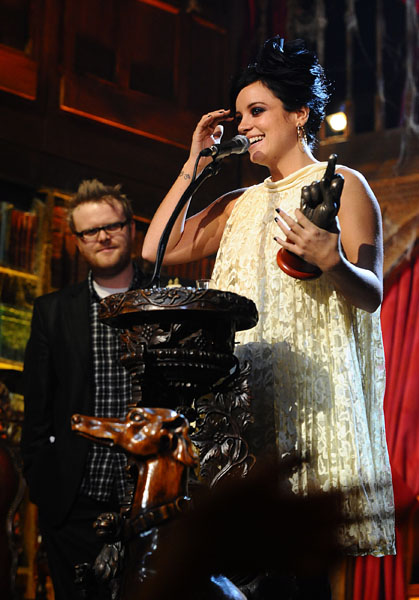 Lilly Allen collects the Giving It Back Fan Award during the 2010 NME Awards at the O2 Academy Brixton, London