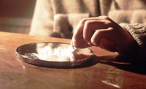 A man using the Class A drug cocaine.