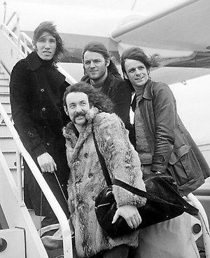 Members of the progressive rock band, Pink Floyd, boarding a chartered Japan Airlines DC8, for their Tour of Japan.  (From left to right) Roger Waters, Nick Mason, Dave Gilmour and Richard Wright.