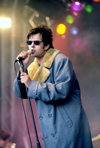 Echo & the Bunnymen frontman Ian McCulloch performing on stage at V97