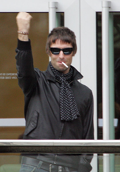 Liam Gallagher and friend are spotted on the balcony at the Lowry Hotel, Manchester.