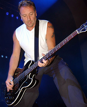 Peter Hook from the group New Order on stage at the Brixton Academy, London.