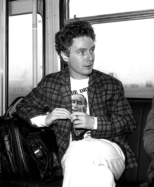 Malcolm McLaren, manager of punk group the Sex Pistols, at Heathrow Airport, London, prior to fling to New York, where group member Sid Vicious was to appear in court accused of knifing to death his girlfriend Nancy Spungen.