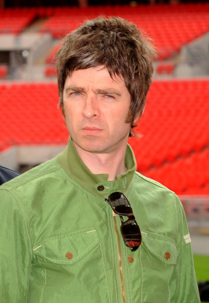Oasis band member Noel Gallagher is pictured during a photocall at Wembley Stadium, where the band announced their biggest ever tour of open air venues in the UK and Ireland next summer.