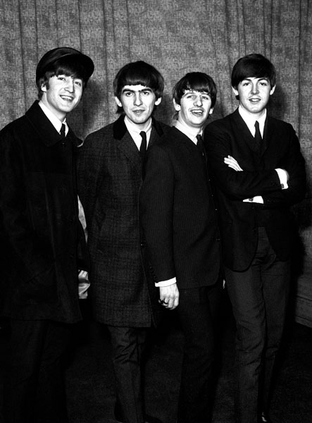 The Beatles, from left to right, John Lennon, George Harrison, Ringo Starr and Paul McCartney, at Heathrow Airport after arriving back from Paris.