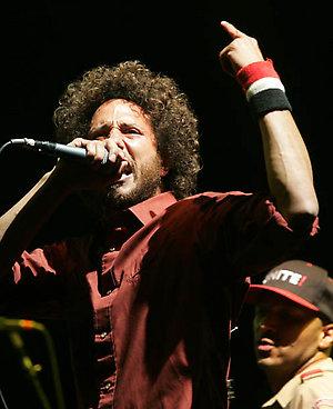 Zack de la Rocha, left, and Tom Morello of Rage Against The Machine perform at the Coachella Valley Music and Arts Festival in Indio, Calif., on Sunday, April 29, 2007. (AP Photo/Branimir Kvartuc)