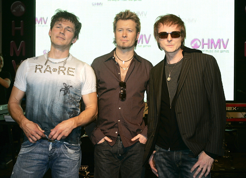Morten Harket, Leif Johansen, Jose Gonzalezt of Scandinavian pop trio A-Ha pose and perform live and signs copies of their latest single, Analogue (All I Want) from their eighth studio album, Analogue, at HMV Oxford Street in London.©Suzan/allactiondigital.com