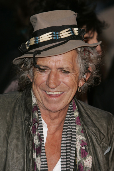 """FILE - In this April 2, 2008 file photo, Keith Richards from the rock band The Rolling Stones poses for photographers as he arrives for the UK premiere of the film """"Shine A Light"""" at the Odeon Leicester Square, in London. (AP Photo/Nathan Strange, file)"""