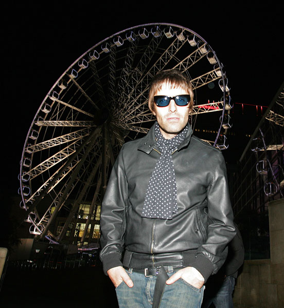 Liam Gallagher takes time out from the Oasis Tour to take a ride on the Manchester Wheel in a VIP pod.