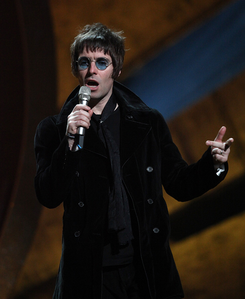 Liam Gallagher on stage to collect the award for 'BRIT's Album of 30 Years' won by Oasis during the BRIT Awards 2010, at Earls Court, London.