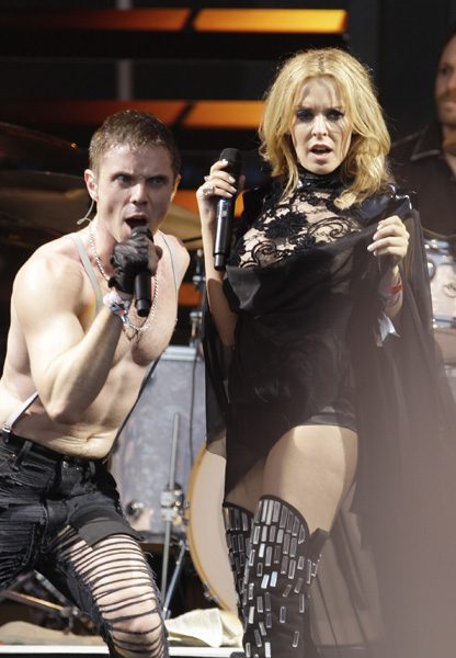 Australian singer Kylie Minogue performs with the Scissor Sisters at Glastonbury Festival, in Glastonbury, England Saturday, June 26, 2010. The Festival celebrates its 40th anniversary this year. (AP Photo/Joel Ryan)